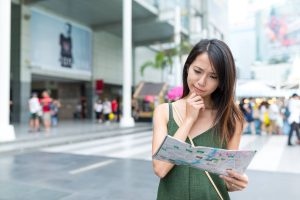 Woman looking at the paper map