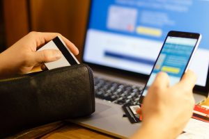 women with credit card making online purchase