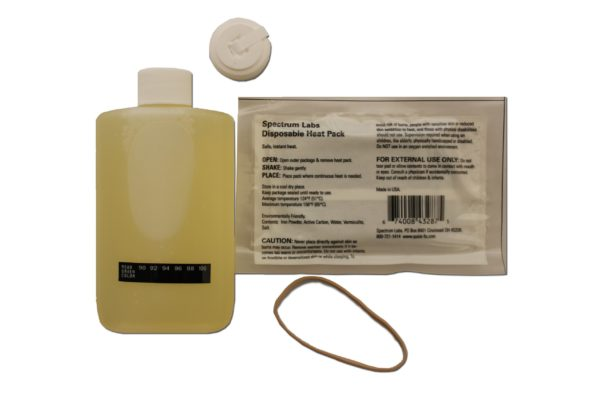 White sachet with labels, container with yellow liquid and other small things